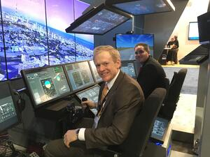 VP David Scott of Lockheed Martin in flight trainer at IITSEC